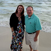 Tim with wife on beach